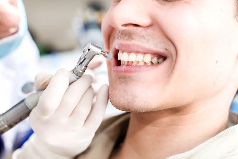 dental patient undergoing cleaning procedure
